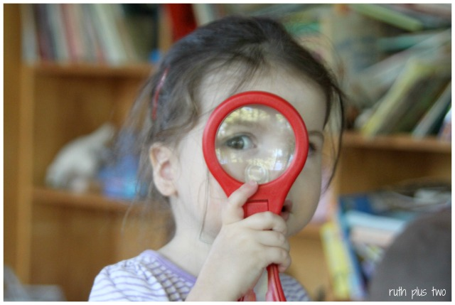 Elena with magnifying glass